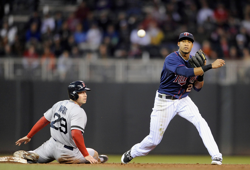 . Daniel Nava of the Boston Red Sox is out at second base as Pedro Florimon of the Minnesota Twins turns a double play in the fifth inning. (Photo by Hannah Foslien/Getty Images)