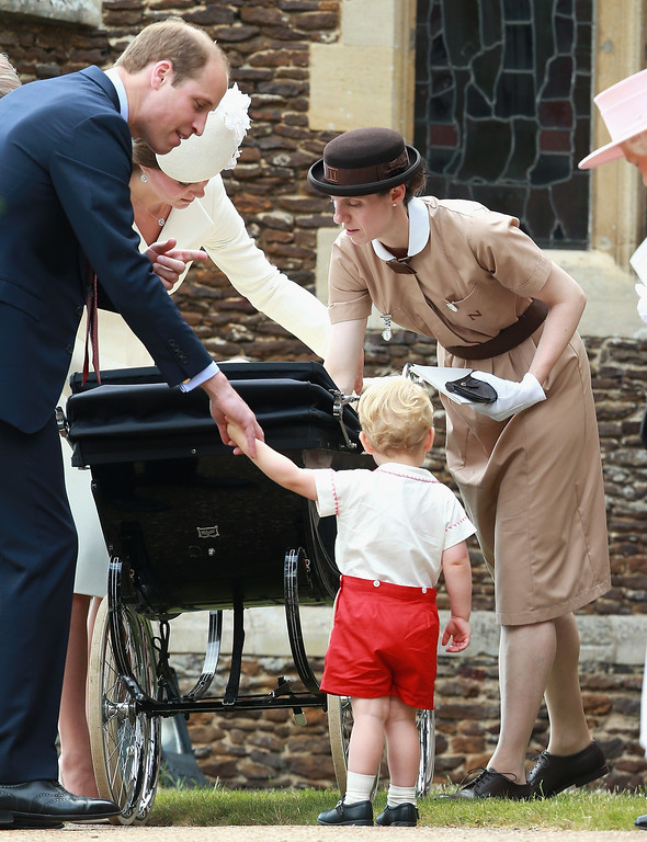 . Prince George\'s nanny, Maria Teresa Turrion Borrallo helps arrange Princess Charlotte of Cambridge\'s pram as she leaves the Church of St Mary Magdalene on the Sandringham Estate for the Christening of Princess Charlotte of Cambridge on July 5, 2015 in King\'s Lynn, England.  (Photo by Chris Jackson/Getty Images)