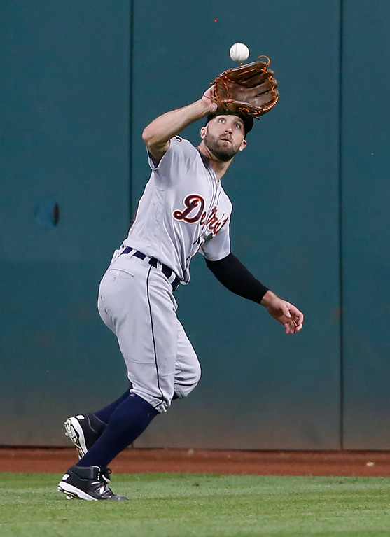 . Detroit Tigers\' Tyler Collins makes a catch to get out Cleveland Indians\' Francisco Lindor during the fourth inning in a baseball game, Tuesday, Sept. 12, 2017, in Cleveland. (AP Photo/Ron Schwane)