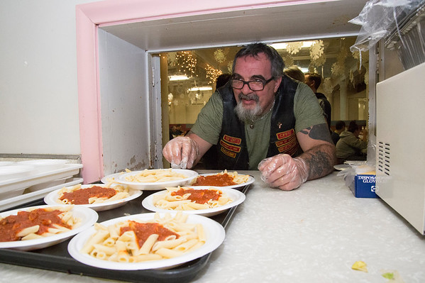 12/05/19 Wesley Bunnell | StaffrrVolunteers at First Lutheran Church in New Britain hold a free pasta dinner every Wednesday night open to all. Duane LaPierre puts together a tray of pasta to bring out.