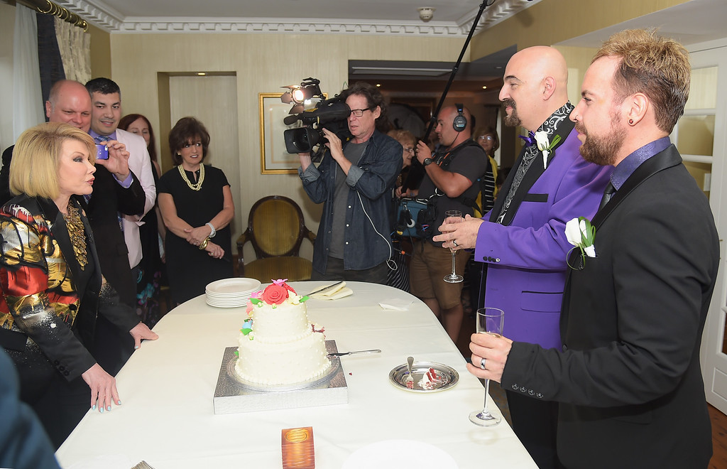 ". TV personality Joan Rivers officiates the gay wedding of Joseph Aiello (L) and William ""Jed\"" Ryan at the Plaza Athenee on August 15, 2014 in New York City.  (Photo by Michael Loccisano/Getty Images)"