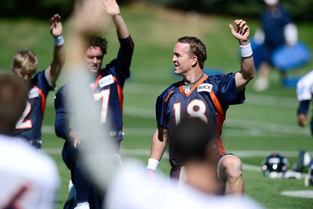 . Denver Broncos quarterback Peyton Manning (18) stretches during OTA\'s May 30, 2013 at Dove Valley. (Photo By John Leyba/The Denver Post)