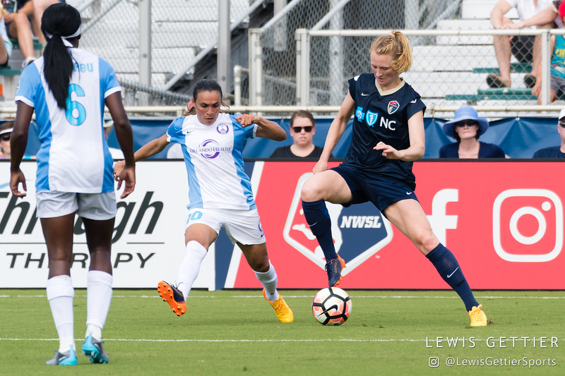 Samantha Mewis (5) and Marta (10) during a match between the NC Courage and the Orlando Pride in Cary, NC in Week 3 of the 2017 NWSL season. Photo by Lewis Gettier.