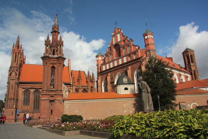 This is actually 2 different churches: On the left is the Gothic masterpiece of St. Anne's Church.  It is believed to have been built between 1495 and 1500. On the right is the 16th century Bernardine Church & Monastery -Vilnius, Lithuania