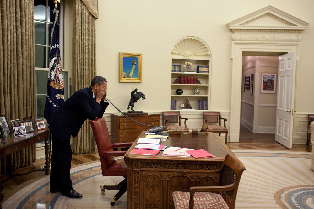 ". March 19, 2010 ""After dinner, the President returned to the Oval Office to continue pressing Congressmen to vote for the health care reform bill. In those final days before the vote, the President made hundreds of calls.\""  (Official White House Photo by Pete Souza)"