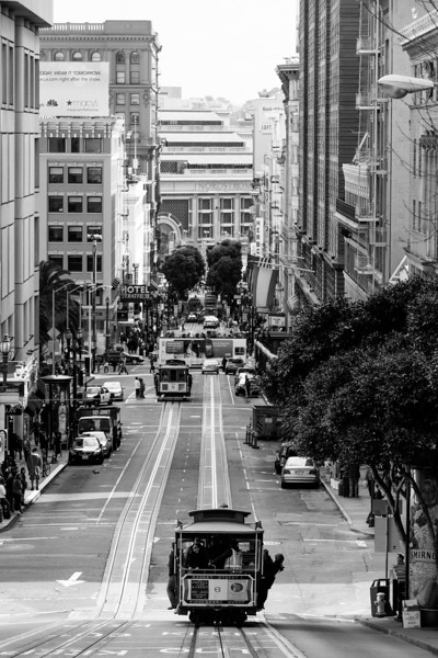 Trolly of San Francisco  No other city looks like this. San Francisco is known for its long streets across large hills. Makes for a very interesting cityscape.  From the daily photo blog of http://alikgriffin.com