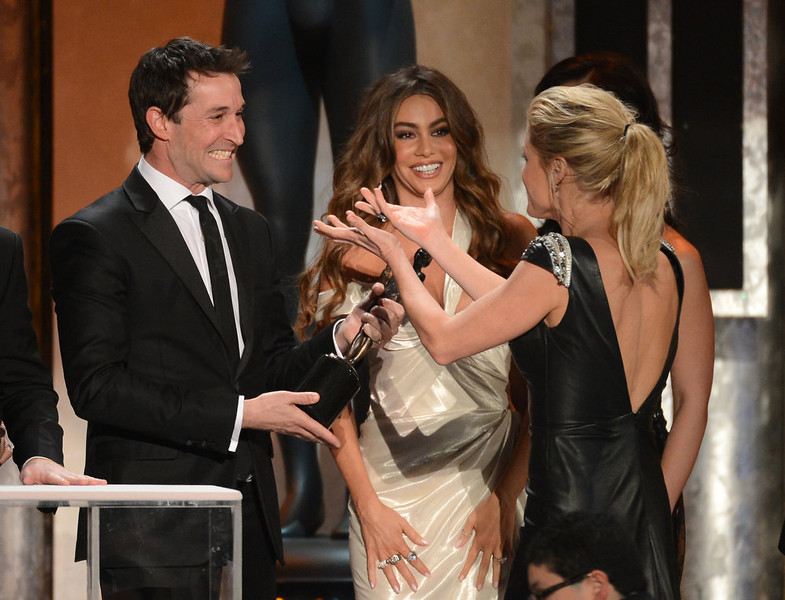 . Actor Noah Wyle (L) presents the award for Outstanding Performance by an Ensemble in a Comedy Series to actors Sofía Vergara (C) and Julie Bowen (R) for \'Modern Family\' onstage during the 19th Annual Screen Actors Guild Awards held at The Shrine Auditorium on January 27, 2013 in Los Angeles, California.  (Photo by Mark Davis/Getty Images)