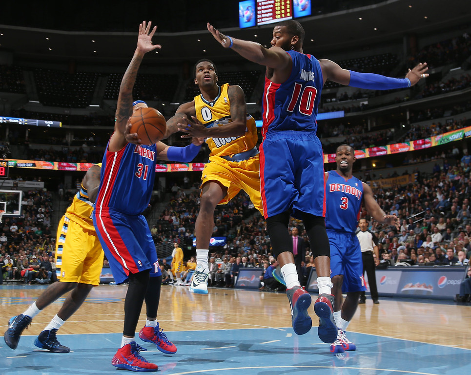 . Denver Nuggets guard Aaron Brooks, second from left, drives lane for basket as, from left, Detroit Pistons forward Charlie Villanueva, center Greg Monroe and guard Rodney Stuckey cover in the fourth quarter of the Nuggets\' 118-109 victory in an NBA basketball game in Denver on Wednesday, March 19, 2014. (AP Photo/David Zalubowski)