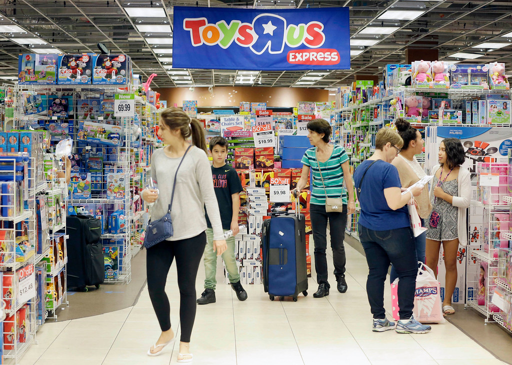 . Shoppers shop in a Toys R Us store on Black Friday, Nov. 25, 2016, in Miami. Stores open their doors Friday for what is still one of the busiest days of the year, even as the start of the holiday season edges ever earlier. (AP Photo/Alan Diaz)