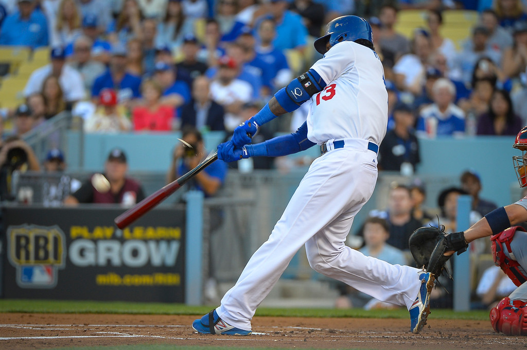 . Dodgers\' Hanley Ramirez get a broken bat single against the Cardinals in the NLCS game 3 at Dodger Stadium Monday, October 14, 2013 (Photo by Andy Holzman/Los Angeles Daily News)