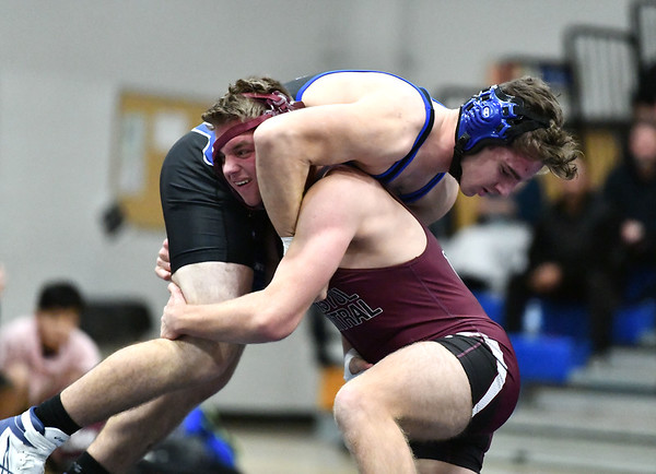 1/8/2020 Mike Orazzi | StaffrBristol Central's Andrew Beaucar and Plainville's Kyle Voisine during Wednesday night's match.