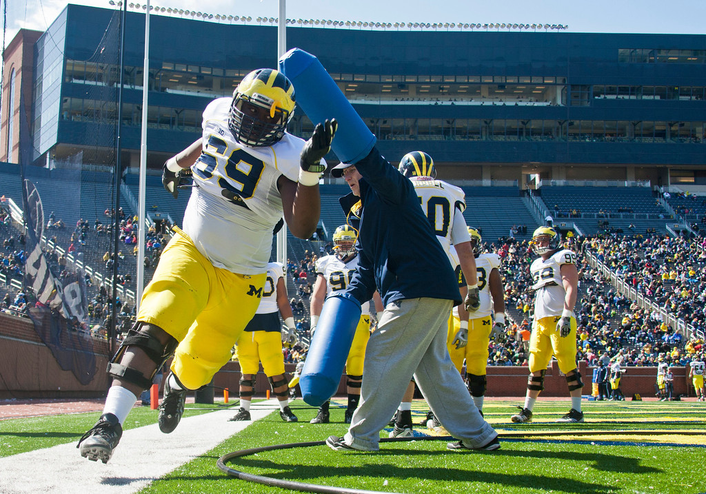 . Michigan defensive tackle Willie Henry (69) runs around a blocking drill during the football team\'s annual spring game, Saturday, April 5, 2014, in Ann Arbor, Mich. (AP Photo/Tony Ding)