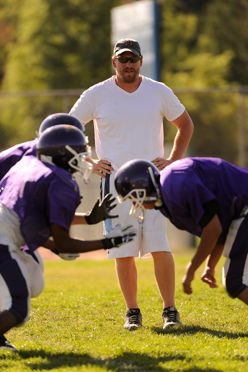 . Former Denver Broncos center Tom Nalen, a volunteer line coach for the South High School Rebels football team.  Nalen coached practice Friday afternoon, August 20, 2009.   Karl Gehring/The Denver Post