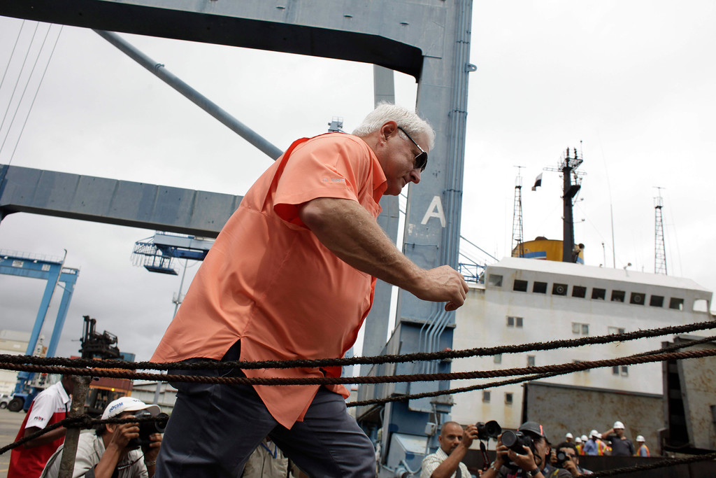 . Panama\'s President Ricardo Martinelli walks up a ramp to the North Korean-flagged ship at the Manzanillo International container terminal on the coast of Colon City, Panama, Tuesday, July 16, 2013. (AP Photo/Arnulfo Franco)