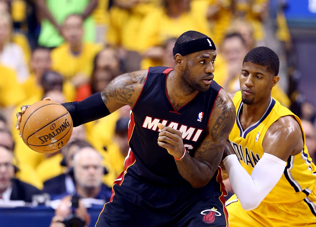 . LeBron James #6 of the Miami Heat controls the ball against Paul George #24 of the Indiana Pacers during Game Two of the Eastern Conference Finals of the 2014 NBA Playoffs at at Bankers Life Fieldhouse on May 20, 2014 in Indianapolis, Indiana.   (Photo by Andy Lyons/Getty Images)