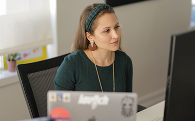Candra Clason Garrett at work as a senior user experience (UX) designer.