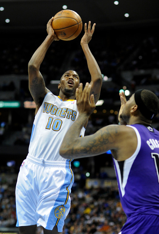. DENVER, CO. - MARCH 22: Julyan Stone (10) of the Denver Nuggets worked above DeMarcus Cousins (15) of the Sacramento Kings in the second half. The Denver Nuggets defeated the Sacramento Kings 101-95 Saturday night, March 23, 2013 at the Pepsi Center. The Nuggets extended its longest winning streak since joining the NBA to 15 games with the win over the Kings. (Photo By Karl Gehring/The Denver Post)