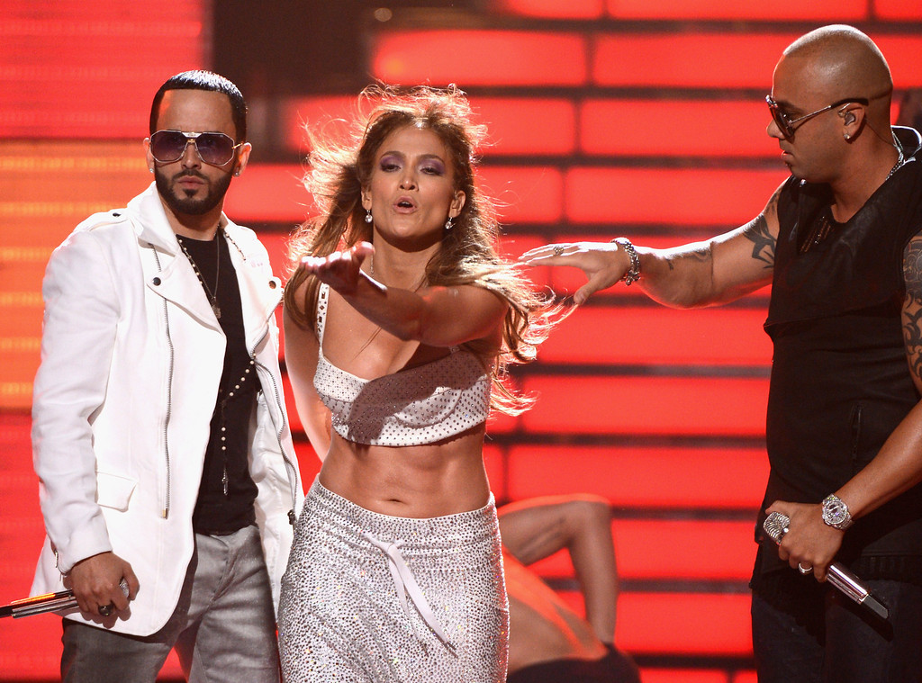 ". LOS ANGELES, CA - MAY 23:  Jennifer Lopez (C) with Yandel (L) and Wisin of Wisin Y Yandel perform onstage during Fox\'s ""American Idol 2012\"" results show at Nokia Theatre L.A. Live on May 23, 2012 in Los Angeles, California.  (Photo by Mark Davis/Getty Images)"
