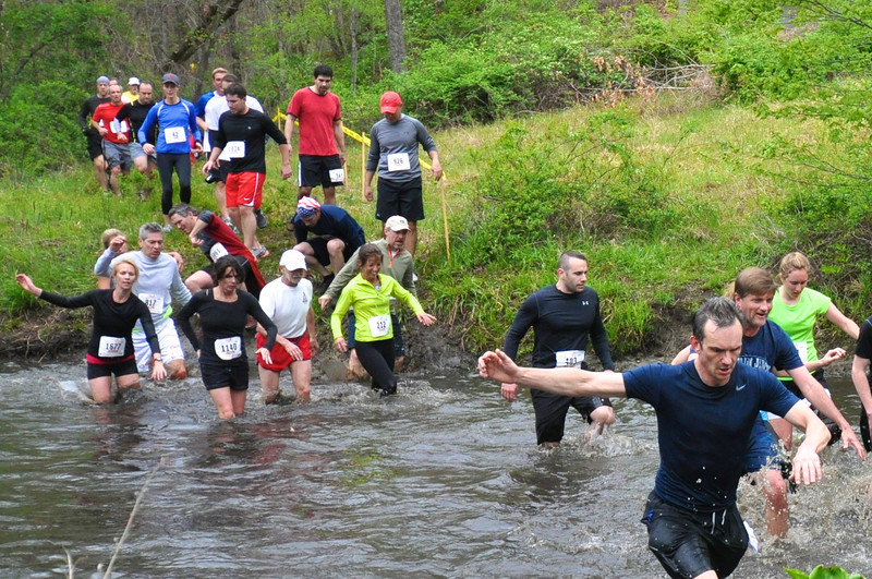 "Runners cross ""Sullivan's Surprise"" in 2012 including Stacy Albanese (#212). Photo by Tom Casper."