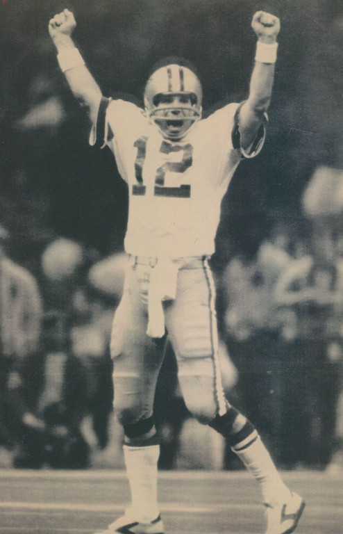 . The Cowboys defensive team dominated most of Super Bowl XII, forcing 8 turnovers and allowing only 8 pass completions by the Broncos for just 61 yards. Two of those interceptions led to 10 first-quarter points. Denver lost 27-10.    New Orleans, Jan. 15 - - Happy After Touchdown Pass - - Dallas quarter - back Roger Staubach shows his jubilation after completing a long touch down pass to his wide receiver Butch Johnson in third quarter action of Super Bowl XII. The Cowboys beat Denver, 27 to 10. Staubach suffered a hand injury during the game. (AP Laserphoto) (g12205stf) 1978  Football - Denver Broncos - Super Bowl Even the calm, cool Roger Staubach showed some emotion when Butch Johnson hauled in TD pass. Credit: AP