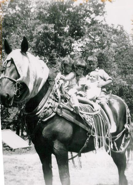 1920s kids on a horse.jpeg
