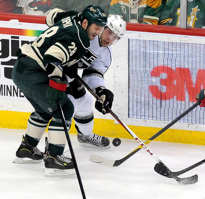 . Minnesota Wild center Zenon Konopka and Los Angeles Kings defenseman Jake Muzzin battle for the puck during the first period. (Pioneer Press: Sherri LaRose-Chiglo)