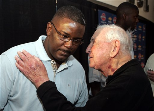 . Detroit Pistons owner Bill Davidson, right, confers with Joe Dumars, team president of basketball operations, after the Pistons introduced two new players at the Palace in Auburn Hills, Mich., Tuesday, July 18, 2006. (AP Photo/Carlos Osorio)