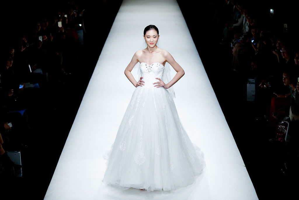. BEIJING, CHINA - OCTOBER 27:  A model showcases designs on the runway at AOLISHA Wei Xinkun Bridal Wear Collection show during day three of Mercedes-Benz China Fashion Week Spring/Summer 2015 at 751D.PARK Workshop on October 27, 2014 in Beijing, China.  (Photo by Lintao Zhang/Getty Images)
