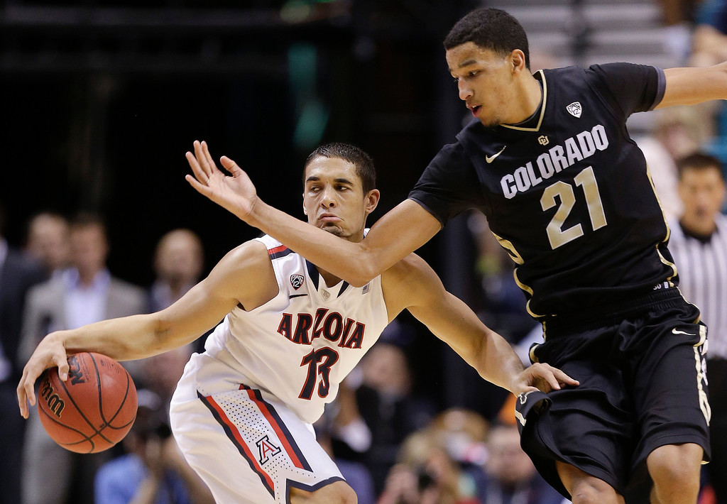 . Arizona\'s Nick Johnson (13) collides with Colorado\'s Andre Roberson during the second half pf a Pac-12 tournament NCAA college basketball game, Thursday, March 14, 2013, in Las Vegas. Arizona won 79-69. (AP Photo/Julie Jacobson)