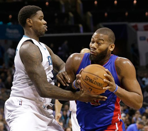 . Detroit Pistons\' Greg Monroe, right, drives against Charlotte Hornets\' Marvin Williams, left, during the second half of an NBA basketball game in Charlotte, N.C., Tuesday, Feb. 10, 2015. The Pistons won 106-78. (AP Photo/Chuck Burton)