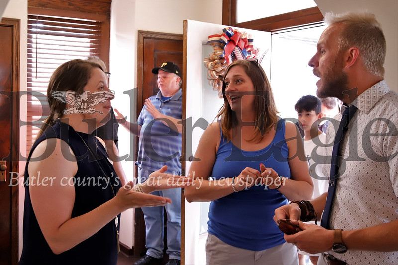 Robin's Home founder Mary Chitwood (left) discusses renovation efforts with friend Christy Rihel and realtor Jared Sullivan at the building's open house Friday. Both Rihel and Sullivan helped find house, now a renovated home for female veterans. Seb Foltz/Butler Eagle