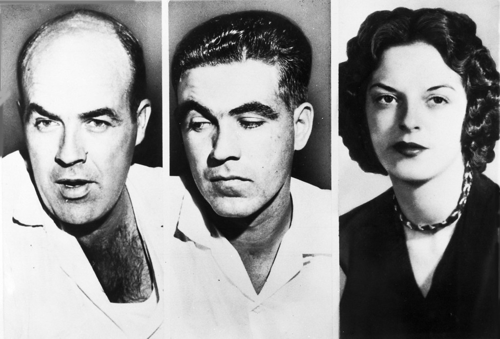 ". John W. Milam, 35, left, his half-brother Roy Bryant, 24 , centre, who go on trial in Sumner, Miss., Sept. 18, 1955, are charged with the murder of 14-year-old African American Emmett  L.Till from Chicago, who is alleged to have ""wolf-whistled\"" and made advances at Bryant\'s wife Carolyn, seen right. (AP Photo)"