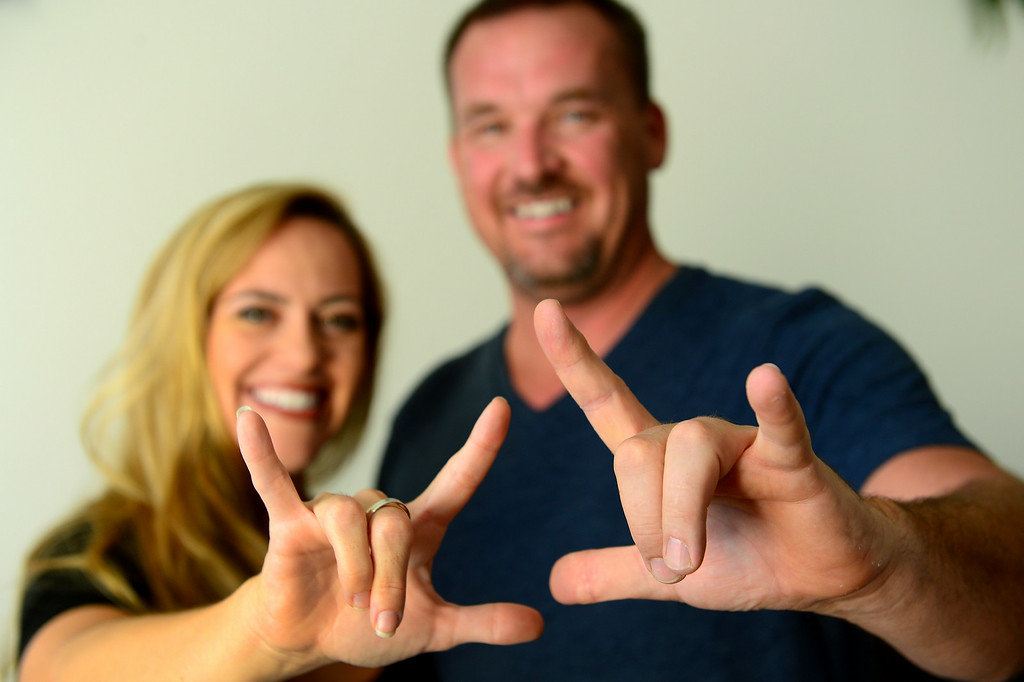 ". Tina Cleveland and Paul Sirimarco sign ""I love you.\"" Videos of the Chatsworth couple performing sign-language videos of hit songs have become popular on YouTube. (Photo by Michael Owen Baker/Los Angeles Daily News)"