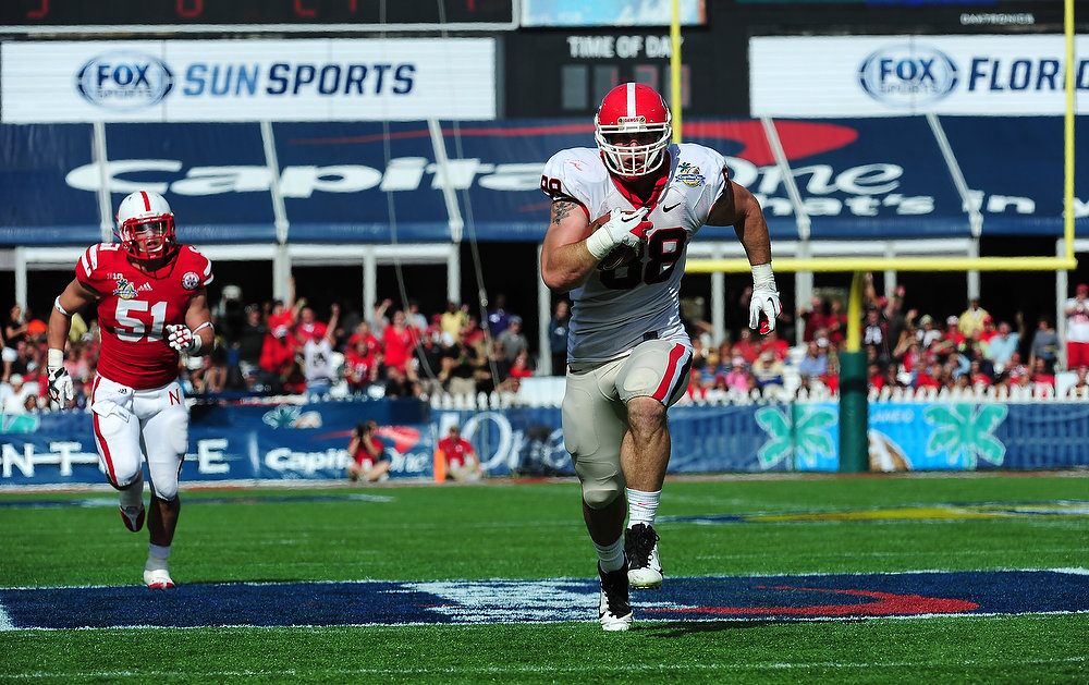 . Arthur Lynch #88 of the Georgia Bulldogs runs with a catch for a first quarter touchdown against the Nebraska Cornhuskers during the Capital One Bowl at the Citrus Bowl on January 1, 2013 in Orlando, Florida. (Photo by Scott Cunningham/Getty Images)