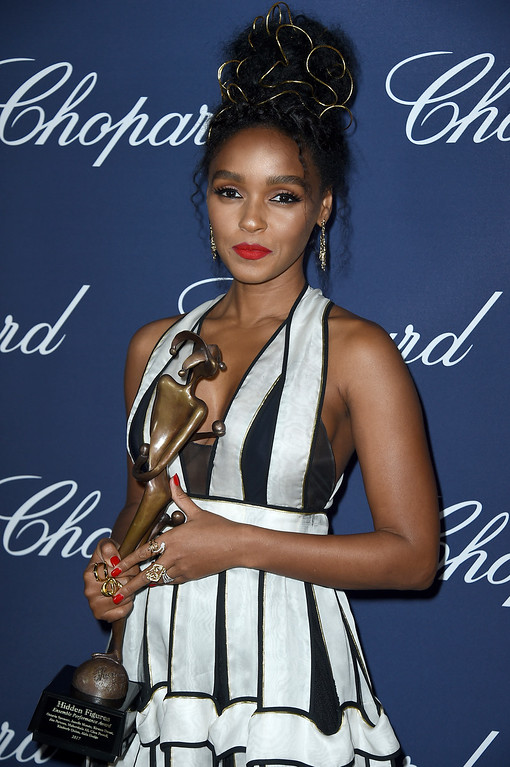 . Janelle Monae poses backstage with the ensemble performance award at the 28th annual Palm Springs International Film Festival Awards Gala on Monday, Jan. 2, 2017, in Palm Springs, Calif. (Photo by Jordan Strauss/Invision/AP)