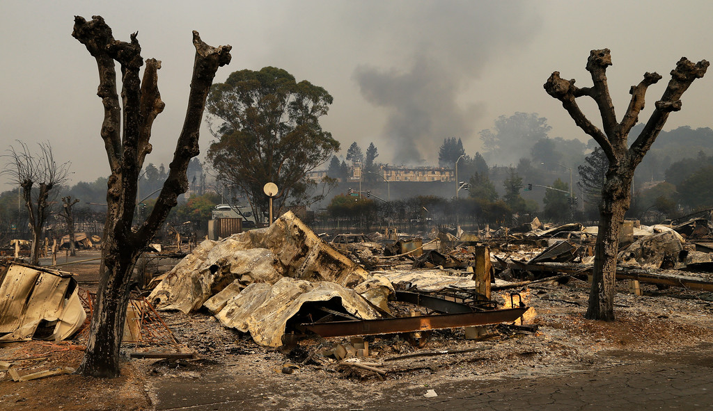 . Remains sit at the Journey\'s End mobile home park on Monday, Oct. 9, 2017, in Santa Rosa, Calif. Wildfires whipped by powerful winds swept through Northern California, sending residents on a headlong flight to safety through smoke and flames as homes burned. (AP Photo/Ben Margot)