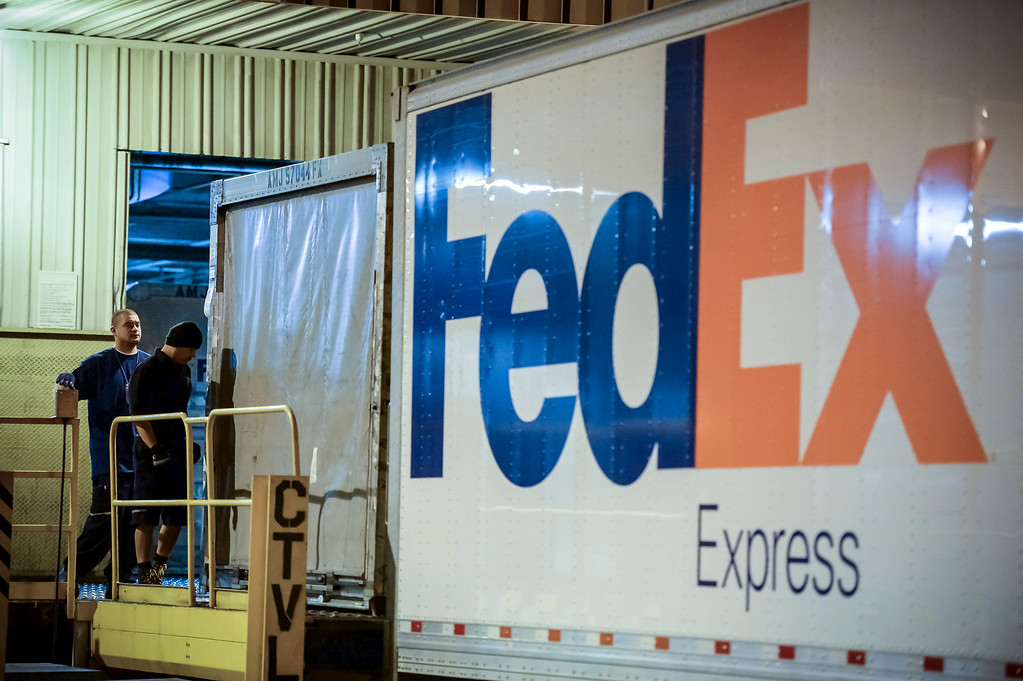 ". Worker load trucks at the FedEx LAX Regional Hub to be distributed to Southern California on ""Cyber Monday\"", December 2, 2013.  (Photo by David Crane/Los Angeles Daily News)"