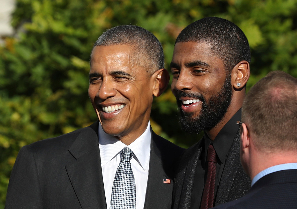 . President Barack Obama poses for a picture with Cleveland Cavaliers point guard Kyrie Irving during a ceremony on the South Lawn of the White House in Washington, Thursday, Nov. 10, 2016, where the president honored the 2016 NBA Champion basketball team.  (AP Photo/Manuel Balce Ceneta)