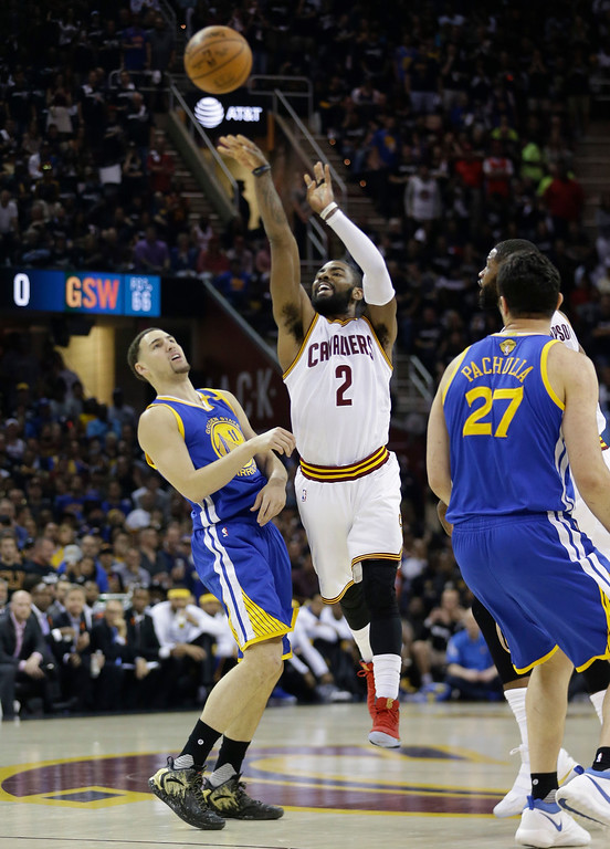 . Cleveland Cavaliers guard Kyrie Irving (2) shoots past Golden State Warriors guard Klay Thompson, left, during the first half of Game 4 of basketball\'s NBA Finals in Cleveland, Friday, June 9, 2017. (AP Photo/Tony Dejak)