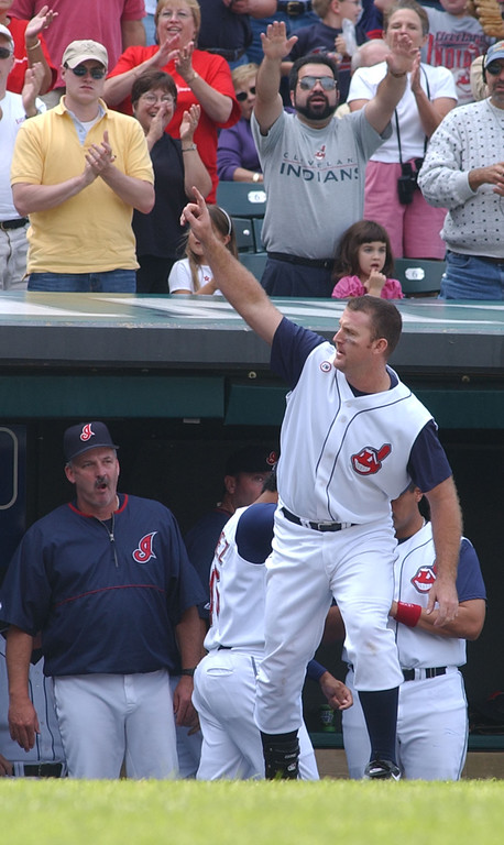 . Cleveland Indian Jim Thome comes out for a standing ovation after scoring a run in the bottom of the 6th inning against the Kansas City Royals, Saturday, Sept. 28, 2002 at Jacobs Field in Cleveland. The Tribe won 7-3. (AP Photo/Haraz Ghanbari)