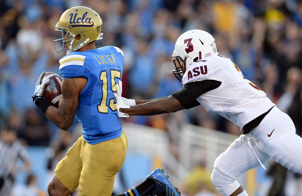 . UCLA�s Devin Lucien #15 scores on a touchdown pass  as Arizona State�s Damarious Randall #3 defends in the first half during their game at the Rose Bowl Saturday November 23, 2013. (Photos by Hans Gutknecht/Los Angeles Daily News)
