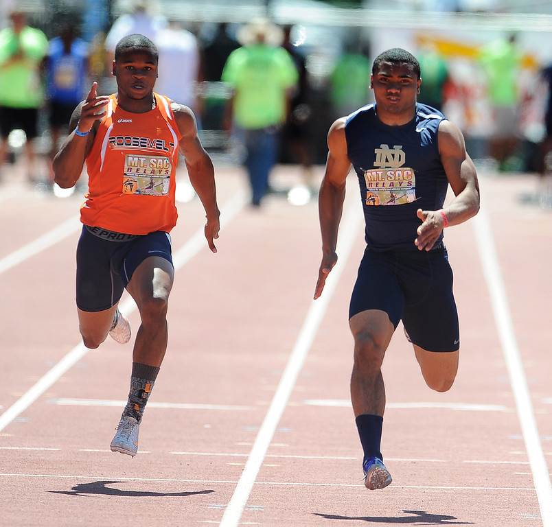 . Khalfani Muhammad, right, of Notre Dame wins the 100 meter dash Invitational High School during the Mt. SAC Relays in Hilmer Lodge Stadium on the campus of Mt. San Antonio College on Saturday, April 20, 2012 in Walnut, Calif.    (Keith Birmingham/Pasadena Star-News)