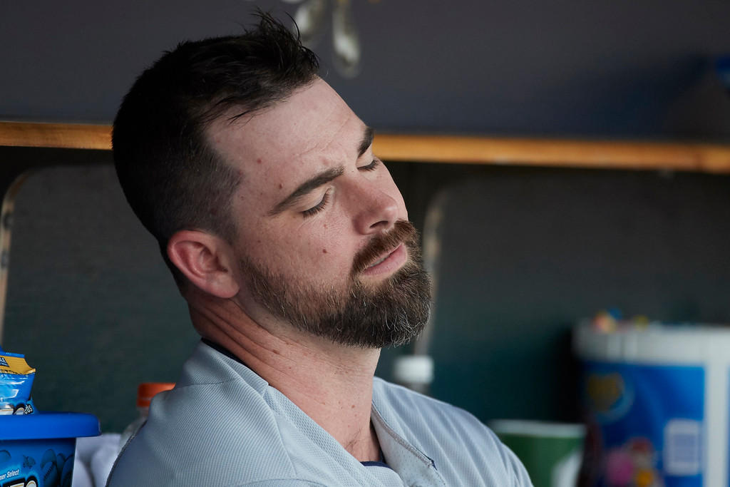 . Cleveland Indians Boone Logan sits in dugout after being relieved against the Detroit Tigers in the ninth inning of a baseball game in Detroit, Sunday, July 2, 2017. Cleveland won 11- 8. (AP Photo/Rick Osentoski)