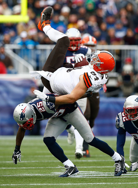. Jordan Cameron #84 of the Cleveland Browns is upended by Kyle Arrington #25 of the New England Patriots after catching a pass in the first quarter during the game at Gillette Stadium on December 8, 2013 in Foxboro, Massachusetts.  (Photo by Jared Wickerham/Getty Images)