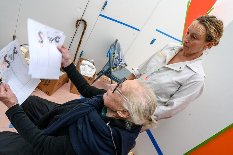 Barbara Stauffacher Solomon  and Nellie Look over the Designs