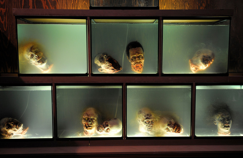 ". ""Walker\"" heads float in fish tanks at AMC\'s \""The Walking Dead\"" booth during the Preview Night event on Day 1 of the 2013 Comic-Con International Convention on Wednesday, July 17, 2013 in San Diego. (Photo by Denis Poroy/Invision/AP)"