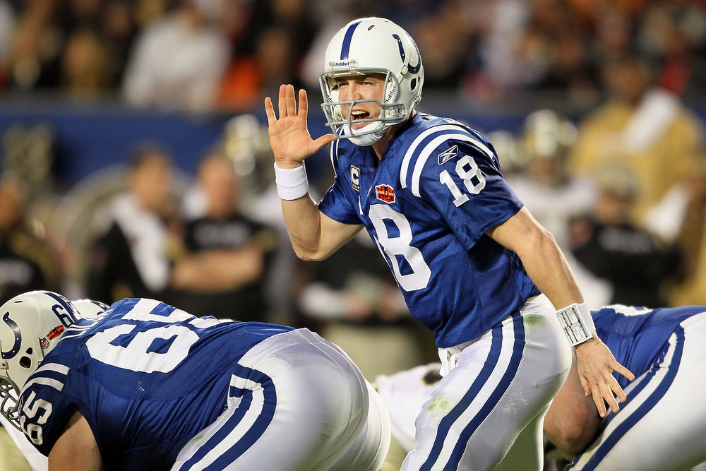 Description of . Peyton Manning #18 of the Indianapolis Colts signals under center against the New Orleans Saints during Super Bowl XLIV on February 7, 2010 at Sun Life Stadium in Miami Gardens, Florida.  (Photo by Andy Lyons/Getty Images)