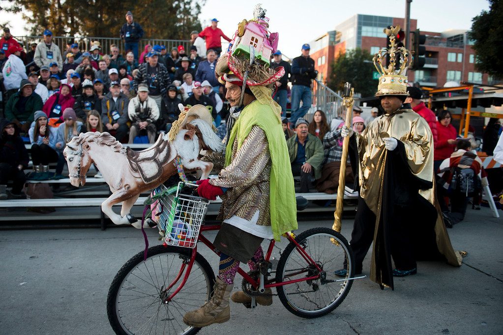 . Parade goers ride through the crowd before the start of the 2014 Rose Parade in Pasadena, Calif. on January 1, 2014. (Staff photo by Leo Jarzomb/ Pasadena Star-News)