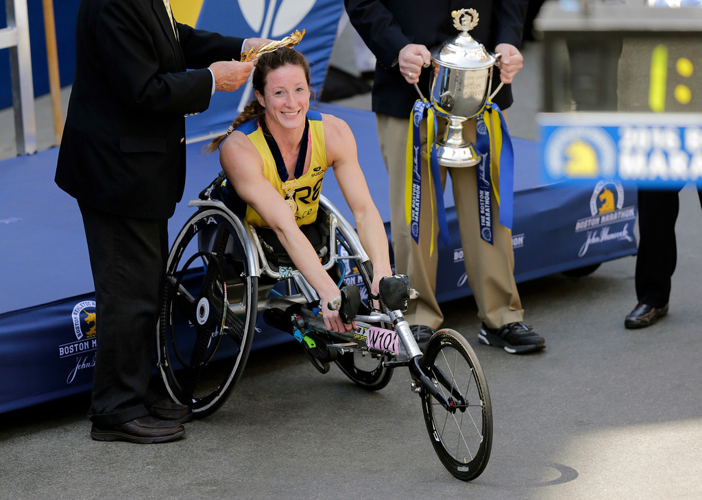 . Tatyana McFadden, of Clarksville, Md., receives her victor\'s wreath and trophy after winning the women\'s wheelchair division of the 120th Boston Marathon on Monday, April 18, 2016, in Boston. (AP Photo/Charles Krupa)