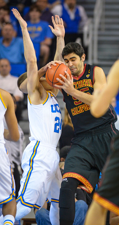 . USC�s Omar Oraby is fouled by UCLA�s Norman Powell during game action at Pauley Pavilion Sunday, December 5, 2014. UCLA  defeated USC 107-73.  Photo by David Crane/Los Angeles Daily News.